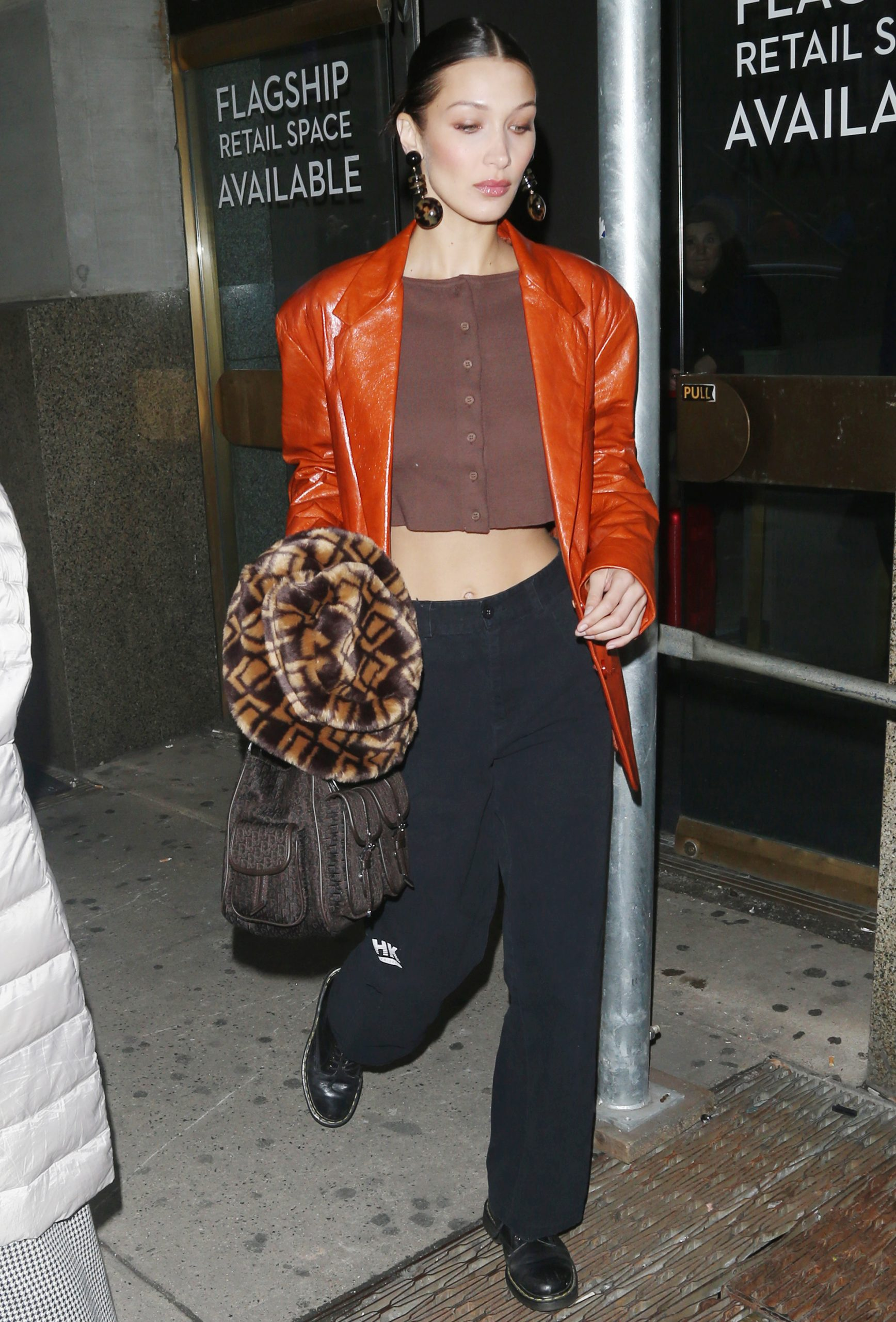 Bella Hadid signs autographs as she makes her way through her car in New York City