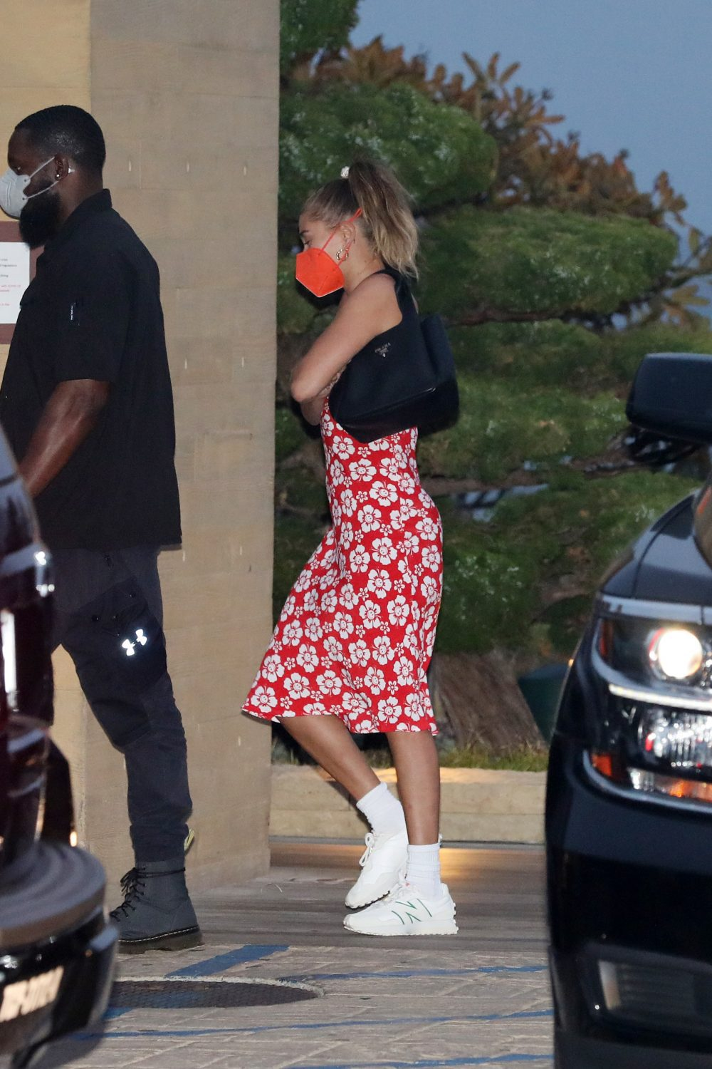 Hailey Bieber wears a red floral dress as she dines at Nobu Malibu